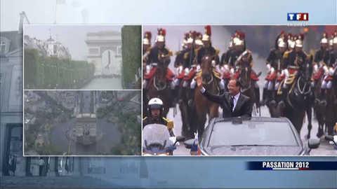 François Hollande remonte les Champs-Elysées sous la pluie